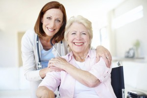 Portrait of a mature nurse and her elderly patient sharing an affectionate moment together